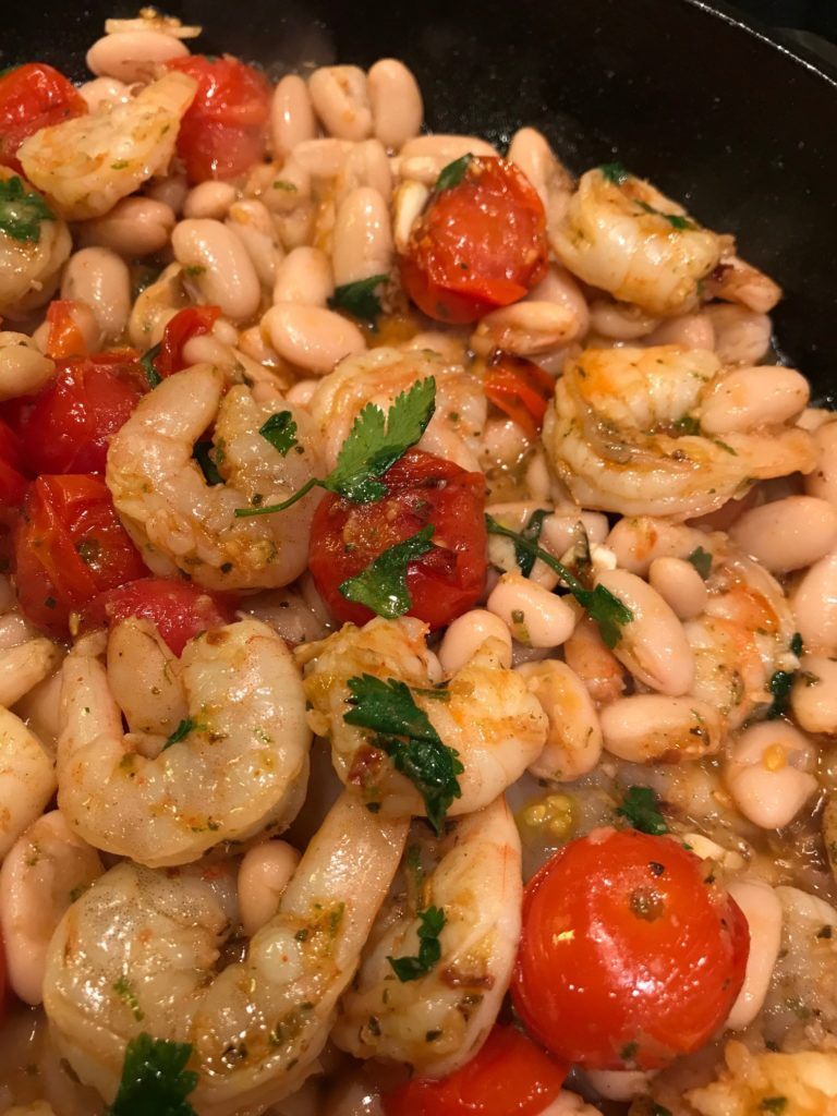 Garlicky Sauteed Shrimp with Creamy White Beans and Blistered Tomatoes